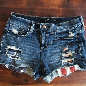 Distressed jean shorts with American flag pockets